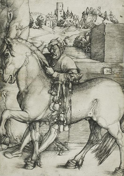 A groom bridling a horse